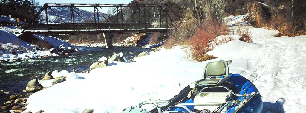 Boat on the banks of the Roaring Fork River in Winter with Vail Valley Anglers in Vail, CO
